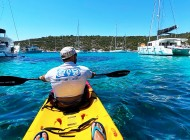 Kayaking-betwen-yacht-in-Blue-Lagoon-Croatia